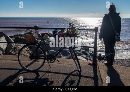 Sidmouth, 29th Oct 18 People out on the rock groynes at Sidmouth after clear overnight skies left a sharp frost across Devon this morning. A bright, sunny day has followed. Photo Central/Alamy Live News - Stock Image