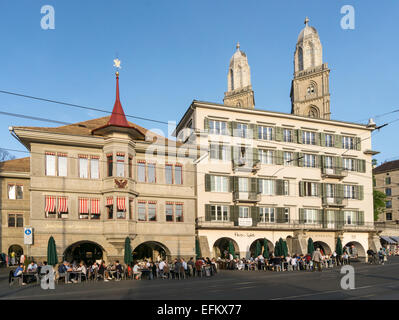 Street Cafe at Limmat Quai, Grossmunster Cathedral, Zurich, Switzerland - Stock Image