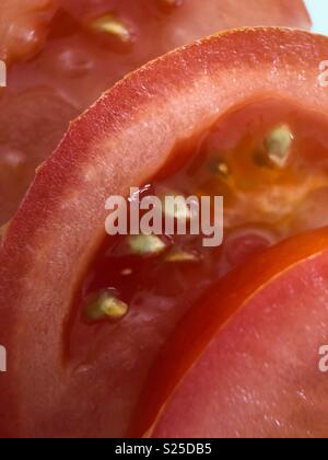 Up close of sliced red tomato - Stock Image