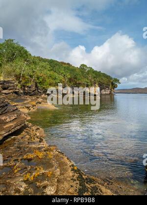 Calm waters of Loch Slapin, cliffs and coastal scenery near Elgol on the beautiful Island of Skye, Scotland, UK - Stock Image