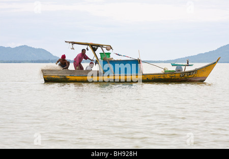 fishermen fishing in traditional way, Bako National Park, Bako, Sarawak, Borneo - Stock Image