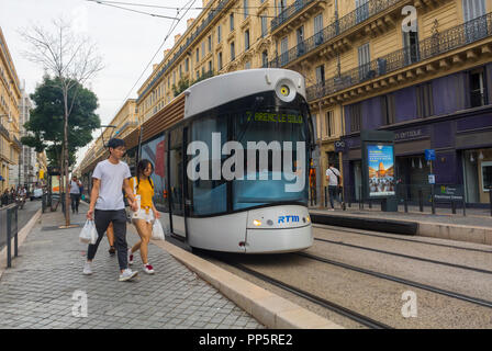 Marseille, FRANCE, Couple Walking on Street, Front of Tram, Public Transport, - Stock Image