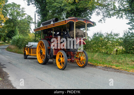 'Raja' a Burrell steam Fairground Engine on a North Yorkshire Country lane - Stock Image