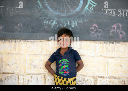 A young Bhil tribe girl outside her village school Rajasthan, India. - Stock Image