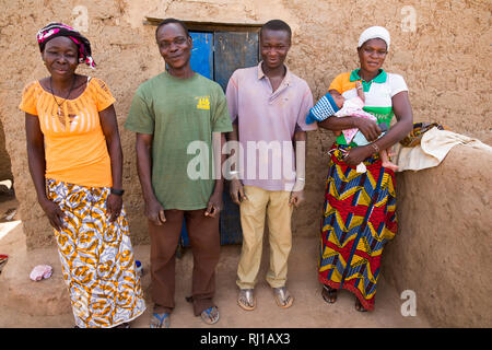 Kourono village, Yako province, Burkina Faso; Moussa Mande, 54,    with his wife Elizabeth Toro, 36, their son, daught-in-law and grand-daughter. - Stock Image