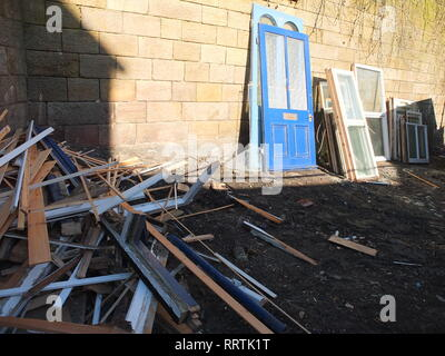 A selection of salvaged doors, windows and broken up window frames at a reclamation yard Sheffield UK - Stock Image