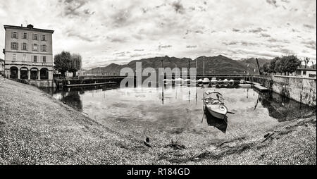 small port of Luino, monochromatic landscape during a gray autumn day - Stock Image