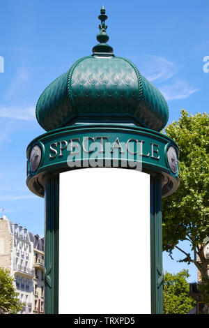 Typical green advertising column or Morris column with blank space in Paris in a sunny summer day in France - Stock Image
