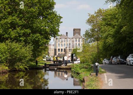People around lock on the Huddersfield Narrow Canal, Slaithwaite, West Yorkshire - Stock Image