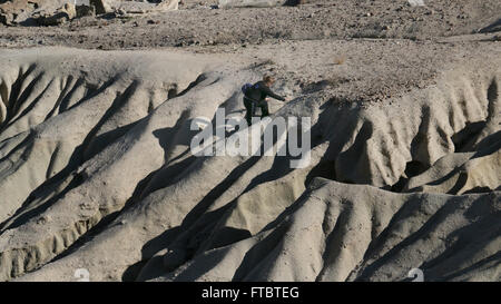 hiker Cliffs and sandstone, tilted rock layers Red Rock Canyon State Park California Mojave Desert - Stock Image