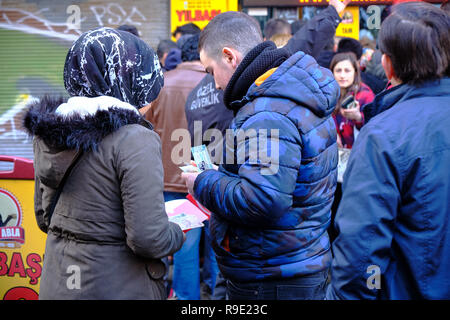 Istanbul, Turkey..  Thousands wait in line to buy ticket for the Turkish national lottery's New Year's eve draw  some waiting over 3 hours from the Nimet Abla in Eminonu Square, an annual tradition due to believed lucky nature of the establishment. This couple just purchased their ticket. - Stock Image