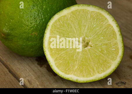 Lime on an old wooden table - Stock Image