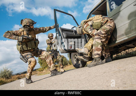 Squad of elite French paratroopers detaining a terrorist in the car. - Stock Image