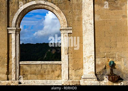 Window in town wall with view into the country, Sorano, Province of Grosseto, Tuscany, Italy - Stock Image