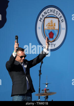 Paul Dickov on stage during the trophy parade in Manchester. - Stock Image