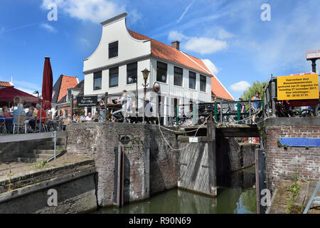 Café t Sluis old, brown café 100 years building 1565, terrace on the water, (a side channel of t IJ), Amsterdam Noord - North, The Netherlands, Dutch, - Stock Image