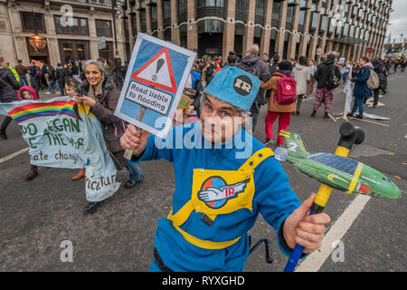 Westminster Bridge, London, UK. 15th Mar 2019. Thunderbirds warn of rising sea levels - Extinction Rebellion organise a Youth After Party which blocks Westminster Bridge. The followed and was attended by School students who were striking over the lack of action on climate change. Credit: Guy Bell/Alamy Live News - Stock Image