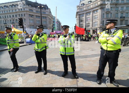 London, UK. 19th Apr, 2019. Increased police cordon seen during the demonstration.Environmental activists from Extinction Rebellion movement occupy London's Oxford Circus for a 5th day. Activists parked a pink boat in the middle of the busy Oxford Circus road junction blocking the streets and causing traffic chaos. Credit: Keith Mayhew/SOPA Images/ZUMA Wire/Alamy Live News - Stock Image