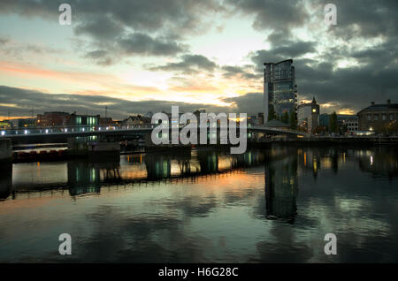 Lagan Weir taken from the east side of the River Lagan looking towards the west side. - Stock Image