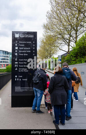An information sign tells visitors to The Tower of London where to go. - Stock Image