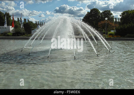 On the Berlin Messe fairground. Fountain in the park. - Stock Image