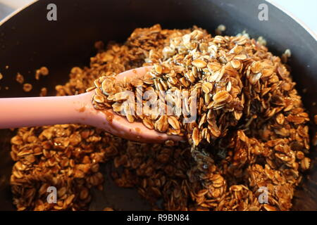 Home baking - making black treacle flapjacks. - Stock Image