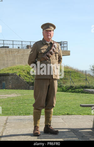 Dover, Kent, UK - September  30 2018:  A guide in military uniform gives a talk about  the 3inch 20cwt AA guns and their use in 1914 mounted on the White Cliffs of Dover. Credit: David Mbiyu - Stock Image