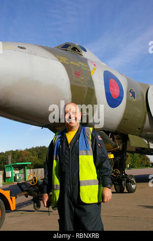 Kevin Taff Stone, chief engineer with Vulcan to the Sky, The Vulcan Operating Company with ex Royal Air Force RAF Avro Vulcan XH558 jet bomber plane - Stock Image