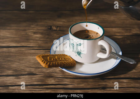 Food espresso coffee with biscuit - Stock Image