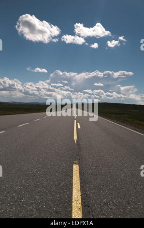 Picture of a empty long road with blue sky - Stock Image