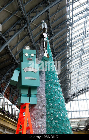 Tiffany & Co Christmas tree and robot in the shopping mall area at St Pancras International Railway Station in London UK  KATHY DEWITT - Stock Image