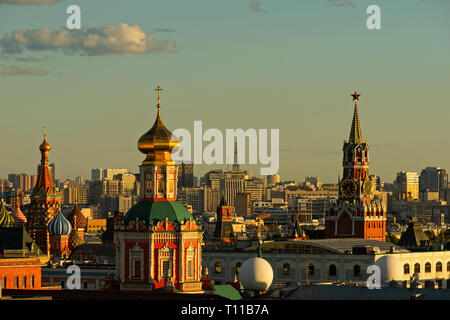 MOSCOW, AUGUST 8, 2018: Moscow city, St. Basil's Cathedral, belfry of Zaikonospassky monastery, and Spassky (Savior's) tower of the Kremlin at summer - Stock Image