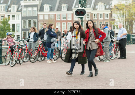 Amsterdam, The Netherlands. Skinny bridge with bikes and tourists. - Stock Image