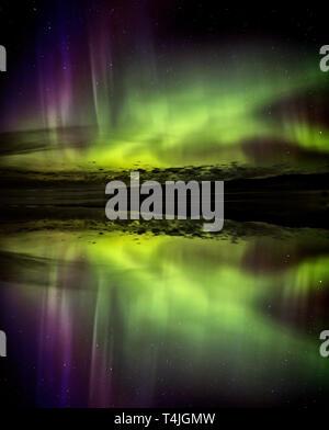 Northern Lights Aurora Reflection colorful lake Canada - Stock Image