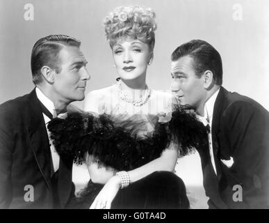 Randolph Scott, Marlene Dietrich and John Wayne / Pittsburgh / 1942 directed by Lewis Seiler (Universal Pictures) - Stock Image