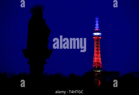 Prague, Czech Republic. 16th Apr, 2019. The lookout tower on Petrin hill in Prague centre was lit in the French national colours, red, blue and white, today, on Tuesday, April 16, 2019, in memory of the yesterday's fire-damaged Notre-Dame Cathedral in Paris. Credit: Vit Simanek/CTK Photo/Alamy Live News - Stock Image