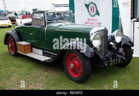 Three-quarter front view of a  Green,1937 Bentley in the Bentley Drivers Club Zone of the 2017 Silverstone Classic - Stock Image