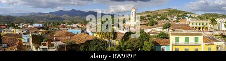 Wide Panoramic View of City Skyline, Bell Tower on Plaza Mayor and Colonial Houses in Trinidad, Cuba - a Unesco World Heritage Site - Stock Image