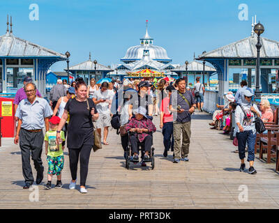 25 July 2018: Llandudno, Conwy, UK Busy Llandudno Pier, during a hot day at the height of the holiday season. - Stock Image