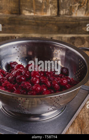 Frozen sweet cherries. Healthy vegan raw plant based food, close up, selective focus - Stock Image