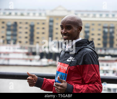 London,UK,24th April 2019,The London Marathon Elite Mens Photocall takes place outside the Tower Hotel with Tower Bridge in the background ahead of the Marathon on Sunday. Taking part are: Sir Mo Farah(GB), Eliud Kipchoge(Ken), Abraham Kiptum(Ken), Shura Kitata(ETH) and Tamirat Tola(ETH). Credit: Keith Larby/Alamy Live News - Stock Image