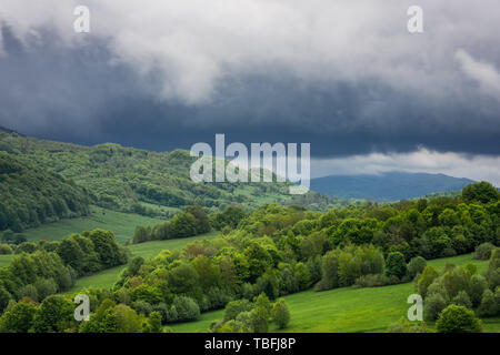 Dramatic stormy weather clouds over peaks in Bieszczady National Park, Poland. - Stock Image