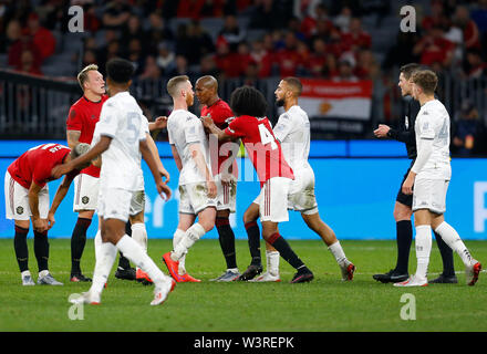 Optus Stadium, Burswood, Perth, W Australia. 17th July 2019. Manchester United versus Leeds United; pre-season tour; Adam Foresaw of Leeds United confronts Ashley Young of Manchester United after a heavy tackle and other players move in to break it up Credit: Action Plus Sports Images/Alamy Live News - Stock Image
