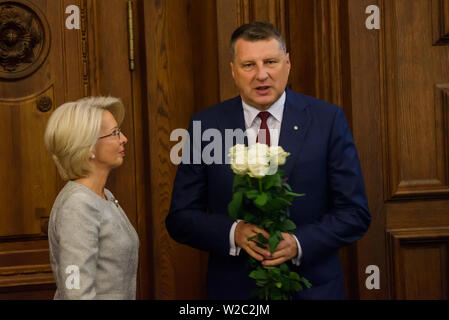 RIGA, LATVIA. 8th of July 2019. Inara Murniece (L) Speaker of Latvian Parliament, giving flowers to Raimonds Vejonis,  former Preseident of Latvia after Egils Levits Solemn oath and address at the extraordinary session of the Saeima (Latvian parliament). Credit: Gints Ivuskans/Alamy Live News - Stock Image