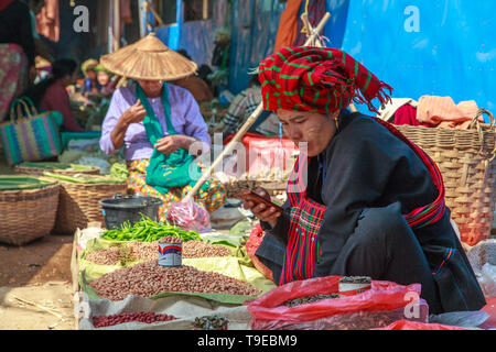 Seller checking her mobile phone - Stock Image