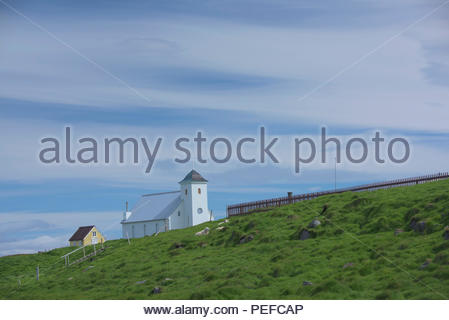 A church on Flatey Island, the largest island of the western islands, located in Breidafjordur on the northwestern part of Iceland. - Stock Image