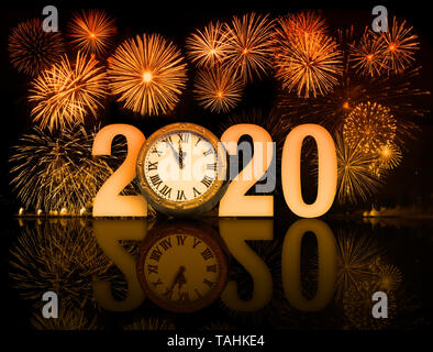 new year 2020 fireworks with clock face - Stock Image