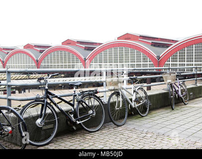 Bicycles parked outside Copenhagen H Central Railway station, Denmark - Stock Image