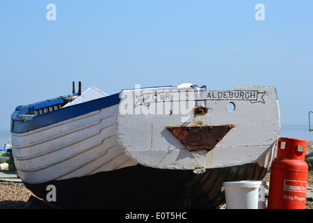 Traditional fishing boats on Aldeburgh Beach inspire artists, composers and visitors. This are permanently beached and historic boats. - Stock Image