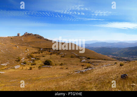 A distant view of 10th Century Rocca Calascio, a mountaintop fortress in the Province of L'Aquila in Abruzzo, Italy. - Stock Image